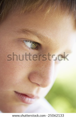 Portrait Of Boy Looking Pensive - stock photo