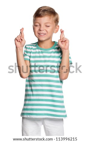 Portrait of boy shows crossed fingers isolated on white background - stock photo