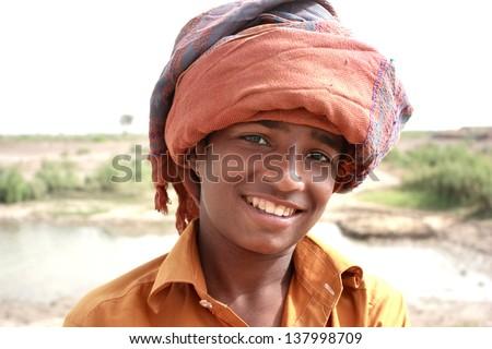 Portrait of boy wearing turban - stock photo