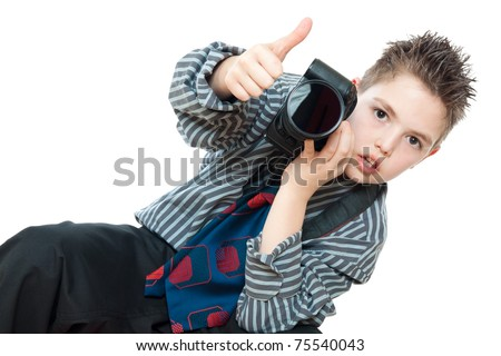 portrait of boy with camera - stock photo