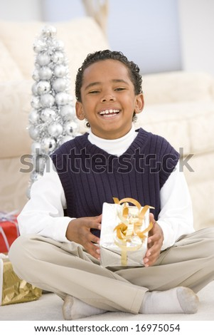 Portrait Of Boy With Christmas Present - stock photo
