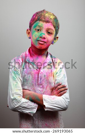 Portrait of boy with face smeared with colored powder. Concept for festival Holi - stock photo