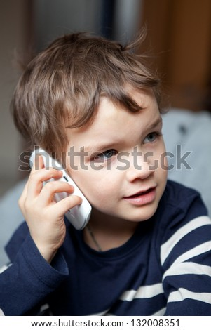 Portrait of boy with mobile phone, indoor - stock photo