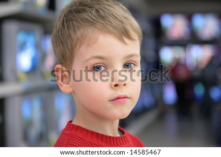 portrait of boyon tv background - stock photo