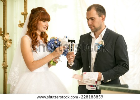 Portrait of bride and groom holding glasses of champagne - stock photo