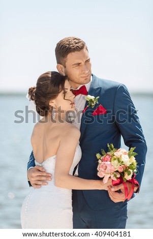 Portrait of Bride and Groom, Posing Against Sunshine on a Beautiful Pier, Romantic Married Couple