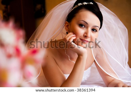 portrait of bride lying on the bed