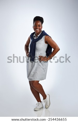 Portrait of british caribbean woman posing in casual dress over white background