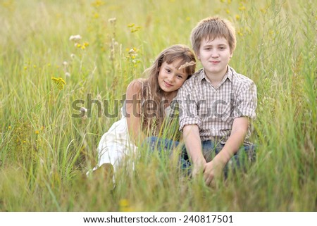 portrait of Brother and sister in summer nature