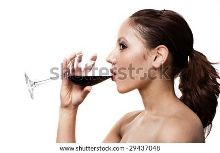 portrait of brunette girl drinking red wine - stock photo