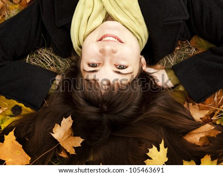 Portrait of brunette girl in the autumn park. Outdoor shot. - stock photo