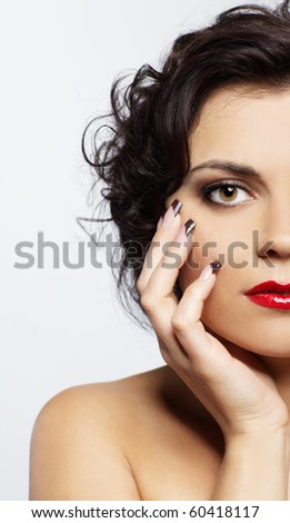 portrait of brunette girl posing on gray - stock photo