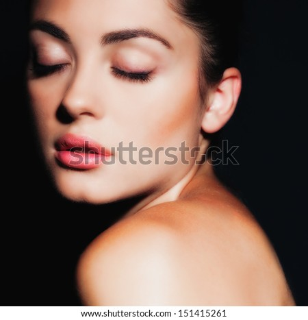 Portrait of brunette girl with the ideal skin, isolated on black background - stock photo