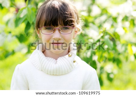 Portrait of brunette preschool girl in glasses - stock photo