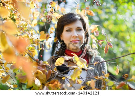 Portrait of brunette woman in september park - stock photo