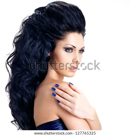Portrait of brunette woman with beautiful long hairs. Fashion model with blue nails. - isolated on white - stock photo