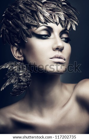 portrait of brunette woman with feather hat - stock photo