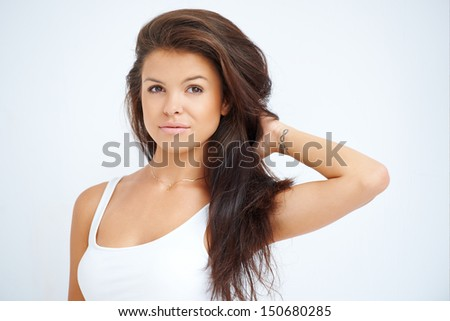 Portrait of brunette young girl posing on white