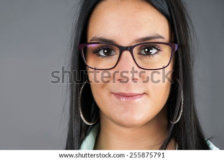 Portrait of brunette young woman with glasses - stock photo