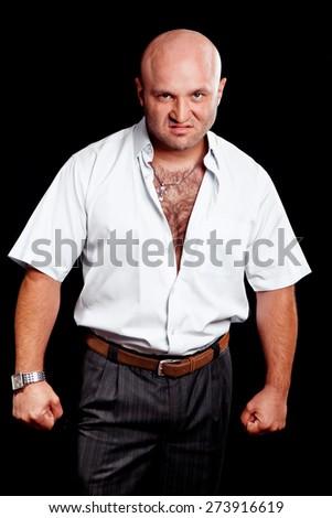Portrait of brutal man on a black background - stock photo
