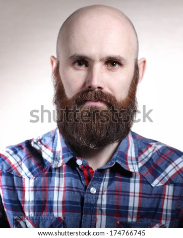 Portrait of brutal man with a beard - stock photo