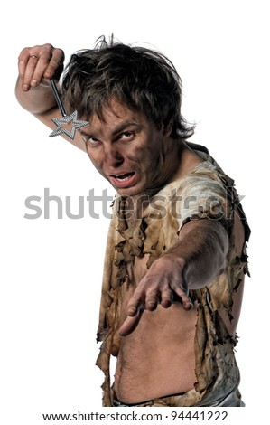 Portrait of burnt man with magic wand over white background - stock photo