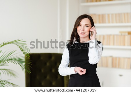 Portrait of business caucasian woman in the office talking on phone - stock photo