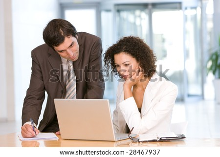 Portrait of business colleagues working on laptop - stock photo