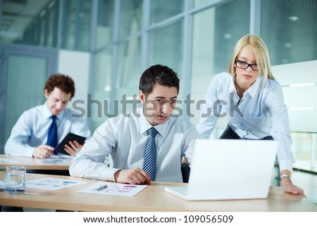Portrait of business colleagues working with laptop - stock photo