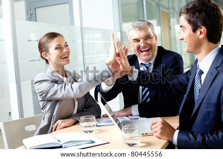 Portrait of business group keeping hands close to each other meaning support - stock photo