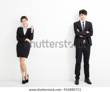 Portrait of business man and woman standing against white background - stock photo