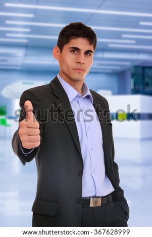Portrait of business man in suit at the office lobby - stock photo