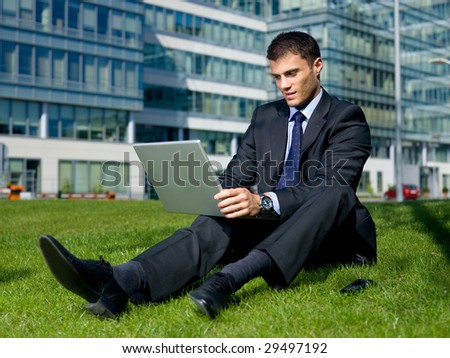 Portrait of business man outside the building - stock photo