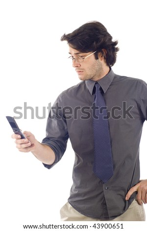 Portrait of Business Man Sending a Text Message Using Mobile Phone Isolated over a White Background
