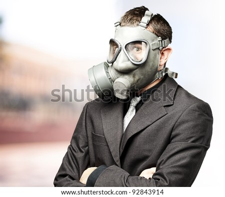 portrait of business man with gas mask against at outdoor