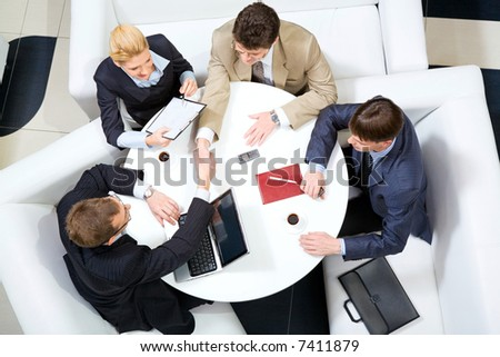 Portrait of business men shaking hands at meeting - stock photo