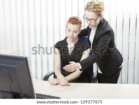 Portrait of business partner studying statistics in front of computer