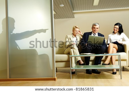 Portrait of business partners working at project during meeting