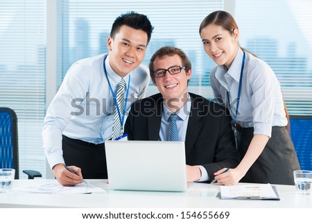 Portrait of business partners working together at the office  - stock photo