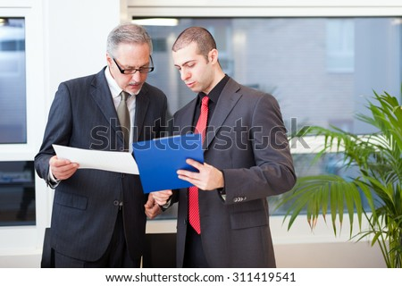 Portrait of business people at work - stock photo