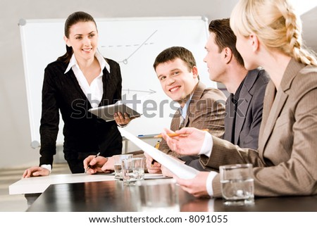 Portrait of business people discussing a new strategy at a seminar - stock photo