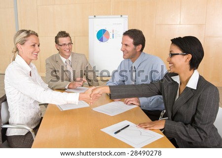 Portrait of business people discussing new strategy - stock photo