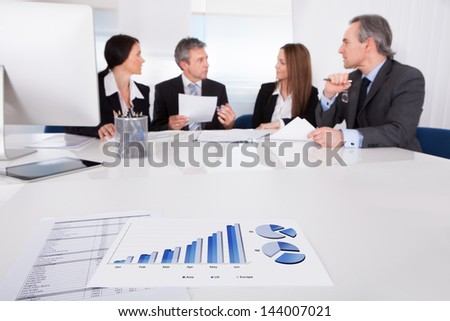 Portrait Of Business People Discussing Plan In Office - stock photo