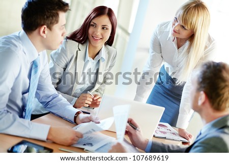 Portrait of business people gathered for a meeting - stock photo