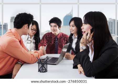Portrait of business people hands shaking together in a business meeting, symbolizing business deal - stock photo