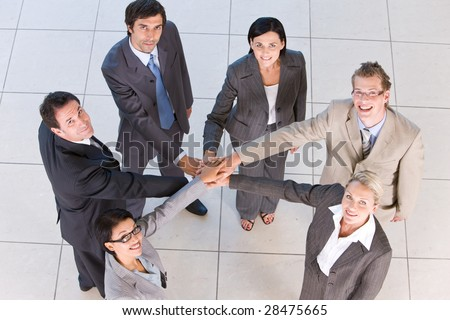 Portrait of business people  holding hands - stock photo