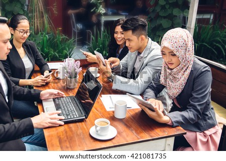 portrait of business people meeting busy working with team at a cafe - stock photo