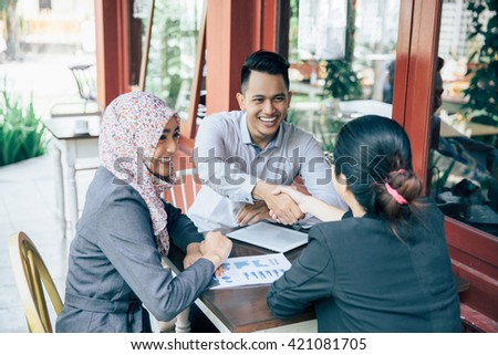 portrait of Business people shaking hands, finishing up a meeting - stock photo