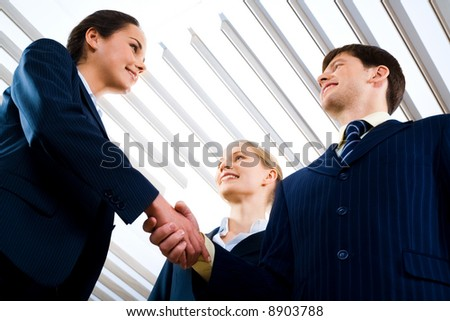 Portrait of business people shaking hands making an agreement - stock photo