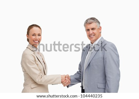 Portrait of business people shaking their hands against white background - stock photo